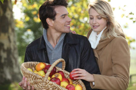 Couple picking apples photo