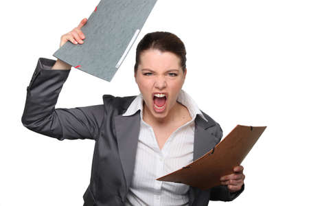 stressed business woman: All this paperwork is driving me insane! Stock Photo
