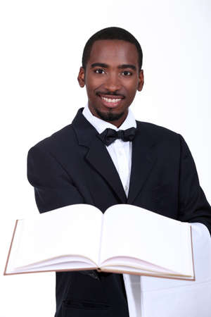 black man presenting a book photo