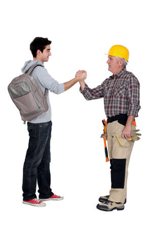 Tradesman making a pact with a young man Stock Photo - 12250510
