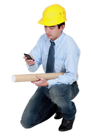 Young architect with a phone Stock Photo - 12250790
