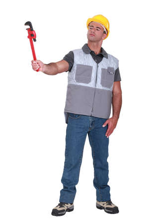 Man holding a pipe wrench photo