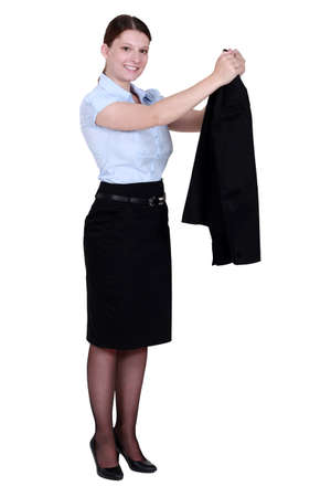 A businesswoman taking off her jacket. photo