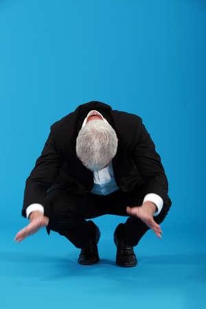 tumble down: Businessman falling over Stock Photo