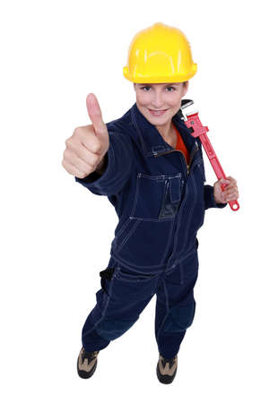 Thumbs up from a female construction worker Stock Photo - 12250639