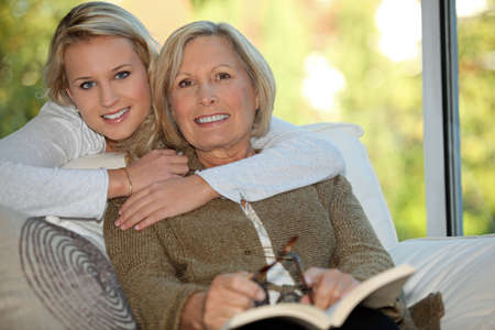 Girl with her grandmother reading a book photo