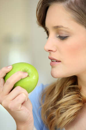 Woman eating an apple Stock Photo - 12251852