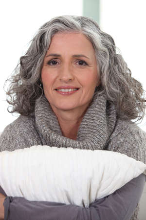 fortysomething: mature grey-haired woman smiling