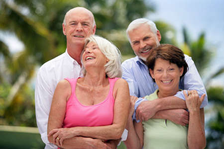 senior couples: Two senior couples in the garden Stock Photo