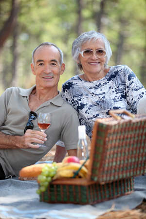 Senior couple enjoying a picnic photo
