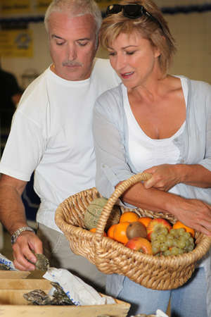 Couple shopping at the market Stock Photo - 12251910