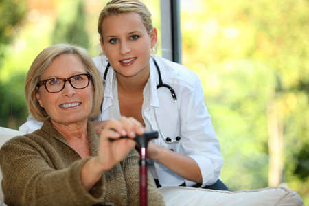 nursing young: Older woman with a nurse Stock Photo