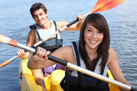 16 19 years: Couple in kayak Stock Photo