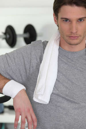 centralize: Young man in the gym