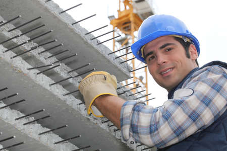 reinforced: Construction worker with slabs of reinforced concrete