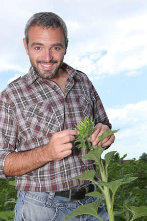 portrait of a man with plant photo