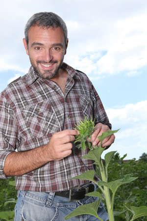 salt pepper: portrait of a man with plant Stock Photo