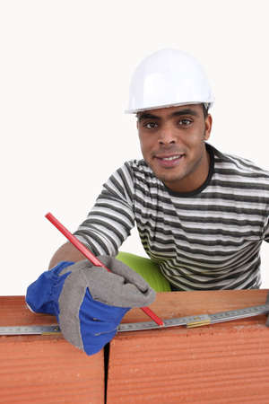 Cheerful bricklayer photo