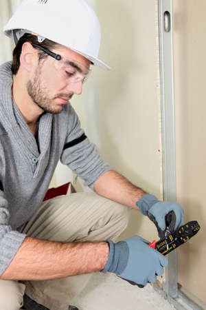 Man cutting electrical wire Stock Photo - 12302376