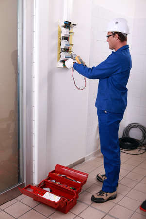 Worker installing electricity photo