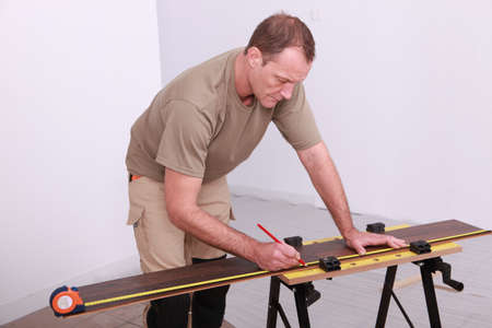 Man working on a workbench photo