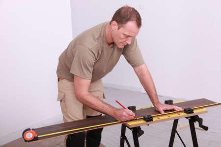 tradesperson: Man working on a workbench