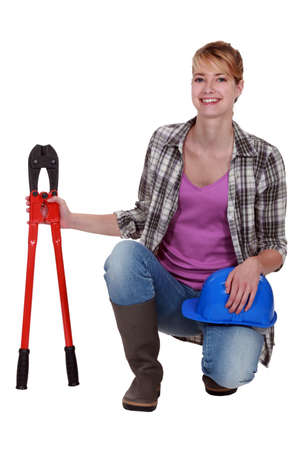 Woman with a pair of bolt cutters Stock Photo - 12302835