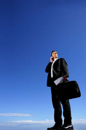 Businessman with briefcase and mobile Stock Photo - 12302821