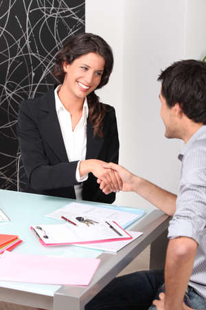 Cheerful woman and man handshaking photo