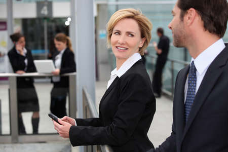 conference call: Businesswoman at an airport Stock Photo