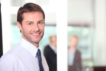 conduct: Man smiling in the office Stock Photo