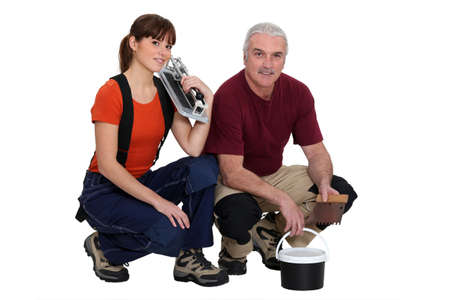 workwoman: A team of tile fitters