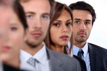 queue: Four young executives