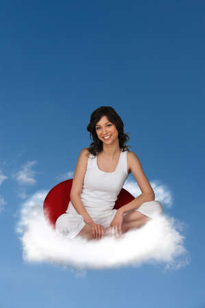 Woman floating on a cloud photo