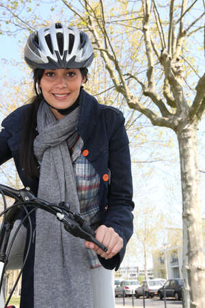 bicycling: Woman riding a bike in the city