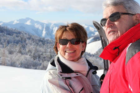 50 to 55 years old: Couple on a skiing holiday