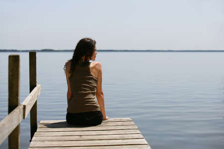 Woman sitting on a pontoon photo