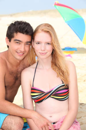 two piece: Young couple on the beach