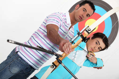 brothers practising archery photo