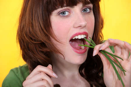 Woman eating chives photo