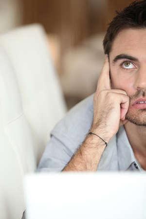 afflict: Man using his laptop Stock Photo