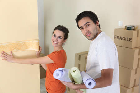 Couple decorating home photo