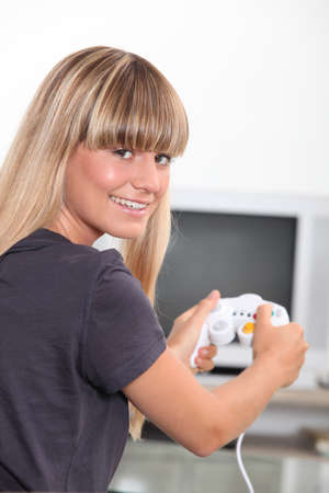 Young woman with a games console handset photo