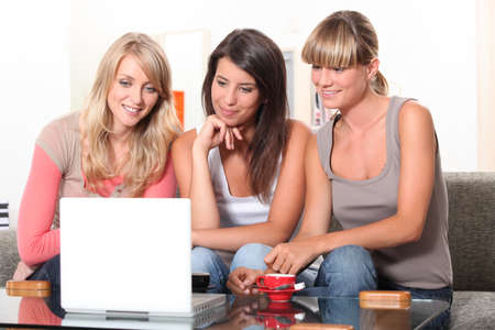 enraptured: Young women watching a film on a laptop