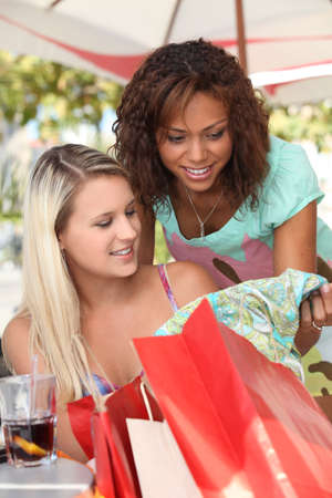 shopping buddies: Two friends with shopping bags Stock Photo