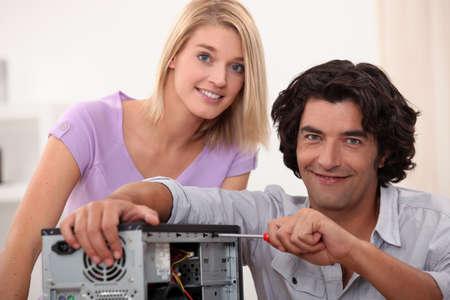 Man repairing computer photo