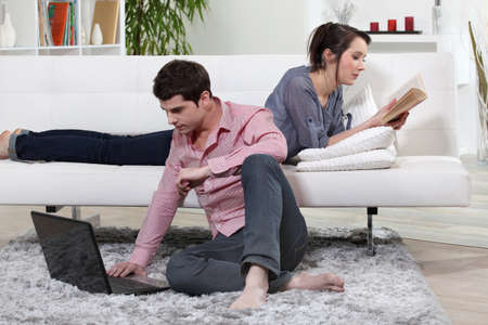 25 35: couple relaxing at home Stock Photo