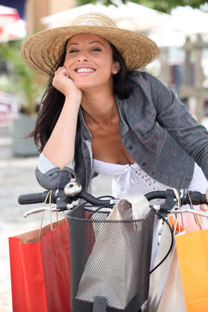 Woman shopping on bike photo