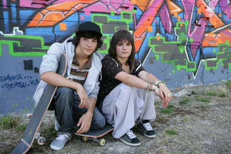 boy and girl skateboarding together photo