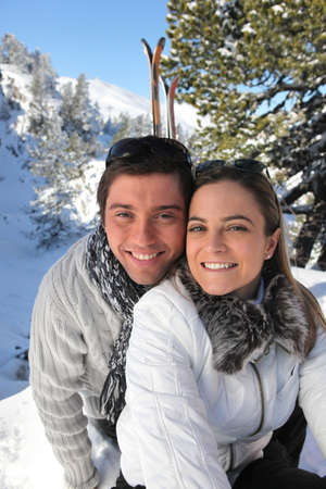 Portrait of a couple skiing in the Alps photo
